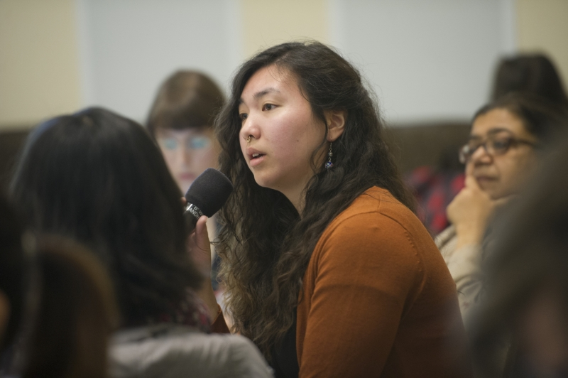Participants ask questions at Feminist Research Institute symposium