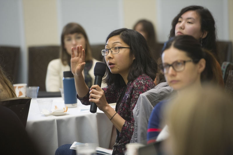 Participants ask questions at the Feminist Research symposium