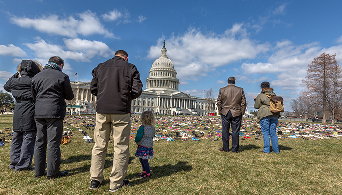 Protestors leave shoes in front of Capitol to protest gun violence