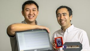 Daniel Fong (left) an electrical and computer engineering Ph.D. student, and Soheil Ghiasi (right), a professor of electrical and computer engineering, are photographed in Ghiasi's lab in Kemper Hall, February 2020. Ghiasi and Fong have invented a patented device that can measure blood oxygen saturation in a fetus through the maternal abdomen.)