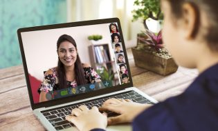 Girl participating in online education training class with teacher and other students using laptop at home. (iStock photo)